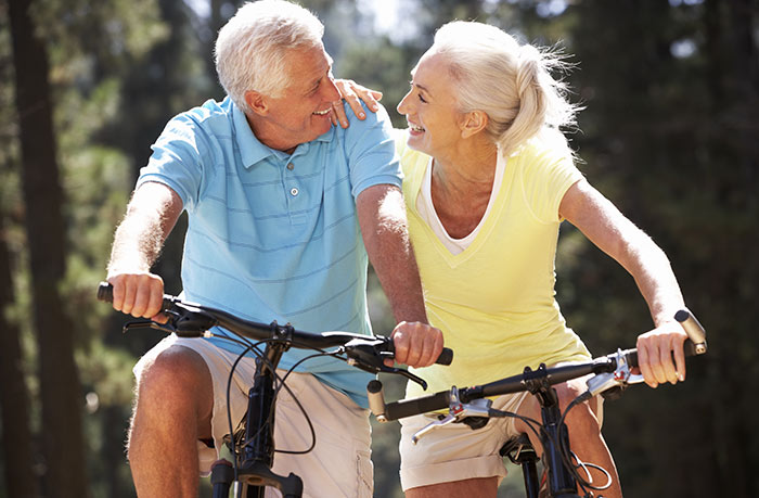 Older Couple Happily Riding Bikes | MCI 911